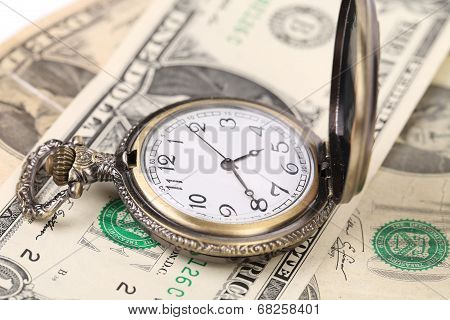 Pocket watch on money.