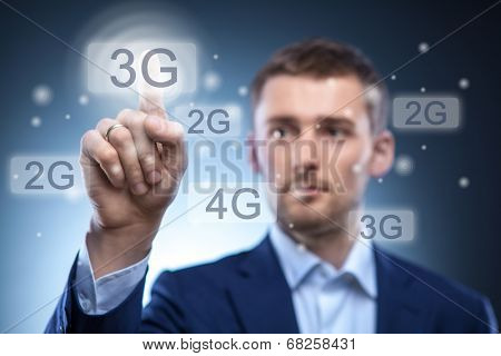 man pressing 3g touchscreen button