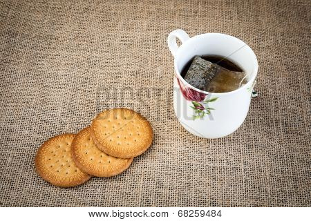 Cup Of Tea With Cake On Fabric Sack