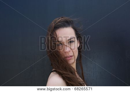 Young Woman With Hair Blowing In Face