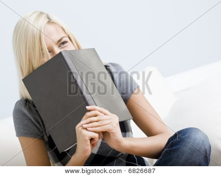 Laughing Woman Holding A Book