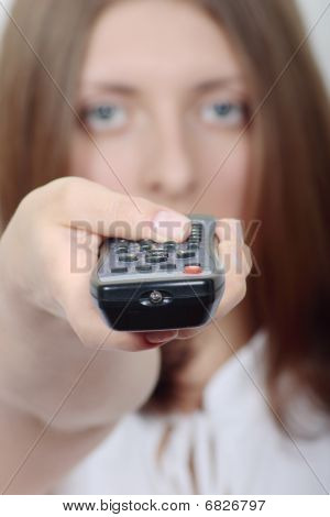 Remote Control On A Background Of The Nice Girl