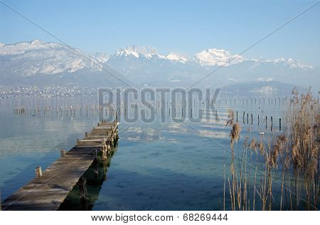 Wood Pontoon And Mountains On Annecy Lake, France