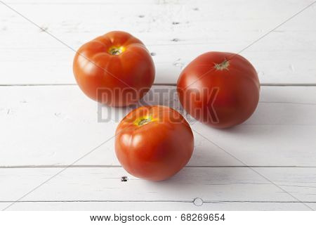 Tomatoes On A White Table