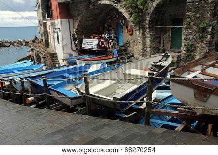 RIOMAGGIORE, ITALY - MAY 02, 2014: Fishing boats in Riomaggiore, Liguria, Italy one of the Cinque Terre villages, UNESCO World Heritage Sites