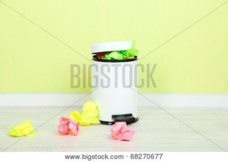 Garbage bin, on green background