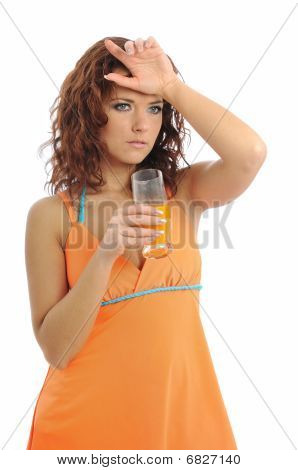 Tired Young Woman Drinking Orange Juice
