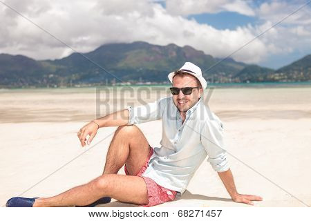 happy young casual man resting on the beach of seychelles