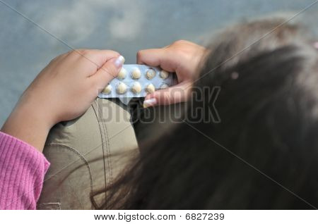 Teenager Decides On Taking Pills