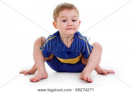 boy doing yoga isolated on white