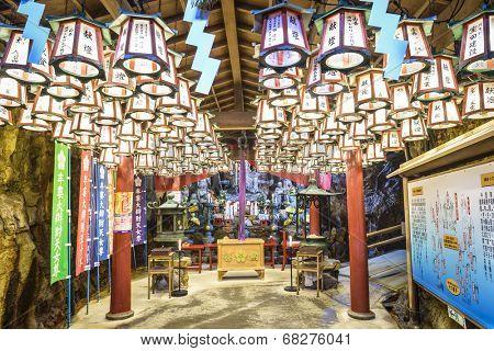 SHIRAHAMA, JAPAN - APRIL 18, 2014: Shrine in the Sandanbeki cavern. The shrine is dedicated to the Goddess Benzaiten.