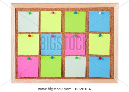 Colorful Paper Notes On Corkboard