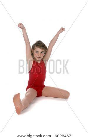 Girl In Red Leotard Doing Split On High Key Background