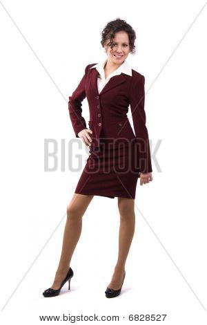 Brunette Businesswoman Dressed In Red Suit.