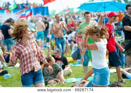 BIG ZAVIDOVO, RUSSIA - JULY 5: People attend open-air rock festival