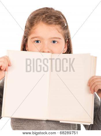 Little Girl Peeking From Behind An Open Book