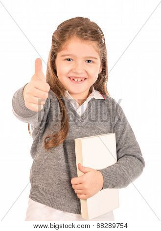 Little Schoolgirl Holding A Book Giving A Thumbs-up
