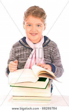 Small Girl In Front Of A Pile Of Books