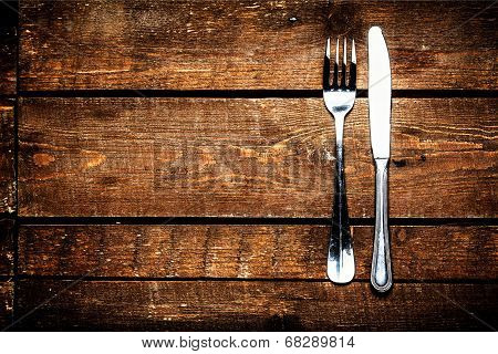 Knife And Fork Over Wooden Table With Copy Space. Diet Food Concept.