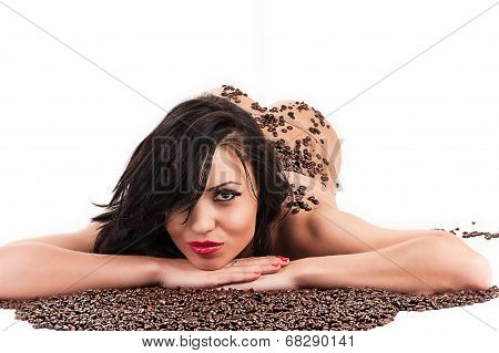 seductive woman lying with coffee beans