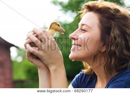 Young Caucasian Woman With Yellow Duckling