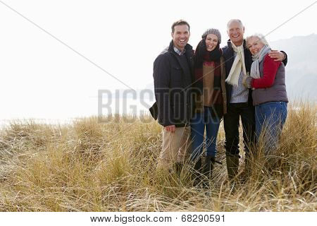 Parents With Adult Offspring Standing In Dunes