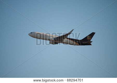 VALENCIA, SPAIN - JULY 10, 2014: An UPS aircraft departing the Valencia airport. UPS is one of largest package delivery companies worldwide with 397,100 employees and USD 54.1 billion revenue (2012).