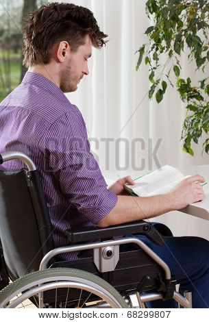 Capable Disabled Man Reading A Book