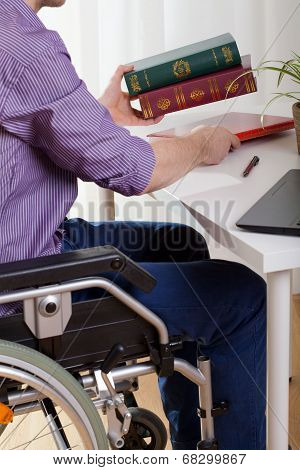 A Disabled Man Sitting And Learns