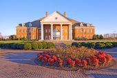 picture of school building  - Communications and Performing Arts Center on the campus of Regent University in Virginia Beach Virginia with a brick walkway blue sky and green grass - JPG