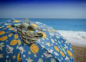 pic of nudist beach  - Beach umbrella with bikini bra on summer day - JPG
