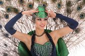picture of female peacock  - Burlesque dancer with peacock feathers and green dress in studio - JPG