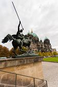 picture of evangelism  - Od view of the Evangelical cathedral also known as Supreme Parish and Collegiate Church with horseman in the forefront in Berlin Germany - JPG