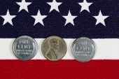stock photo of world war one  - Closeup view of United States One Cent Pieces original World War II dates placed on American Flag - JPG