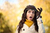 picture of jaw drop  - Amazed fashionable woman with mouth open looking surprised raising her glasses in autumn - JPG