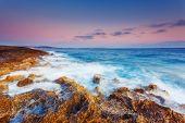 stock photo of volcanic  - Amazing morning sun over the sea - JPG