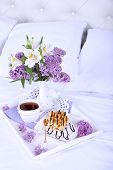 stock photo of bed breakfast  - Wooden tray with light breakfast on bed - JPG