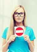 foto of no entry  - picture of woman with no entry sign  - JPG