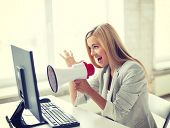 image of pissed off  - picture of crazy businesswoman shouting in megaphone - JPG