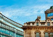 foto of victorian houses  - Modern architecture next to old architecture in London featuring modern glass building and old victorian houses - JPG