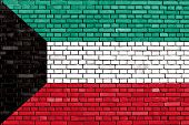 stock photo of kuwait  - flag of Kuwait painted on brick wall - JPG