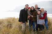 foto of multi-generation  - Multi Generation Family In Sand Dunes On Winter Beach - JPG