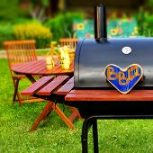 picture of bbq party  - BBQ Party scene pn backyard. Wooden heart with sign BBQ