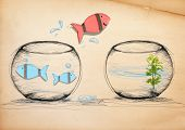 stock photo of fishbowl  - Fish Escaping to New Fishbowl - JPG