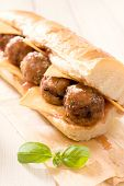 foto of meatballs  - Submarine sandwich stuffed with meatballs and tomato sauce - JPG