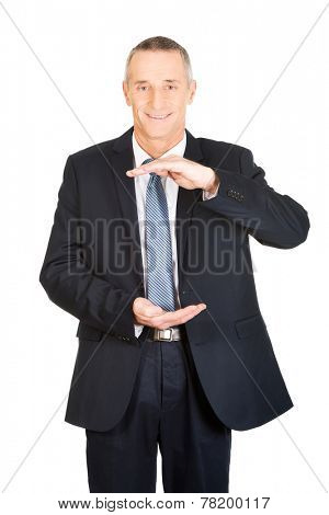 Happy businessman displaying invisible product.