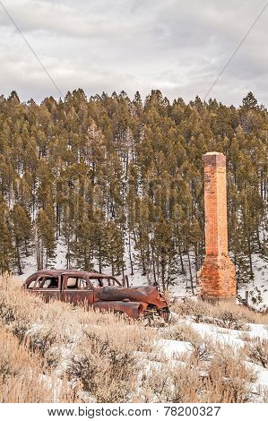Rusty Auto And Brick Chimney