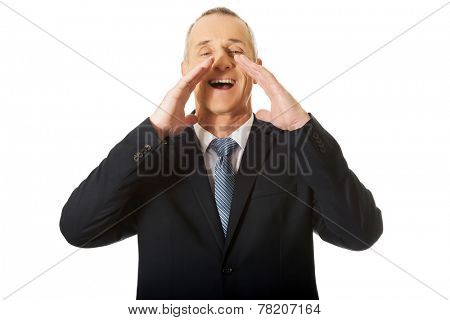 Portrait of businessman calling for someone.
