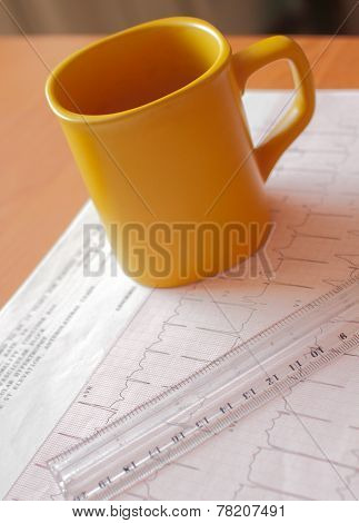 A cup and ruler