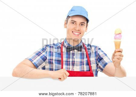 Young cheerful man holding an ice cream isolated on white background